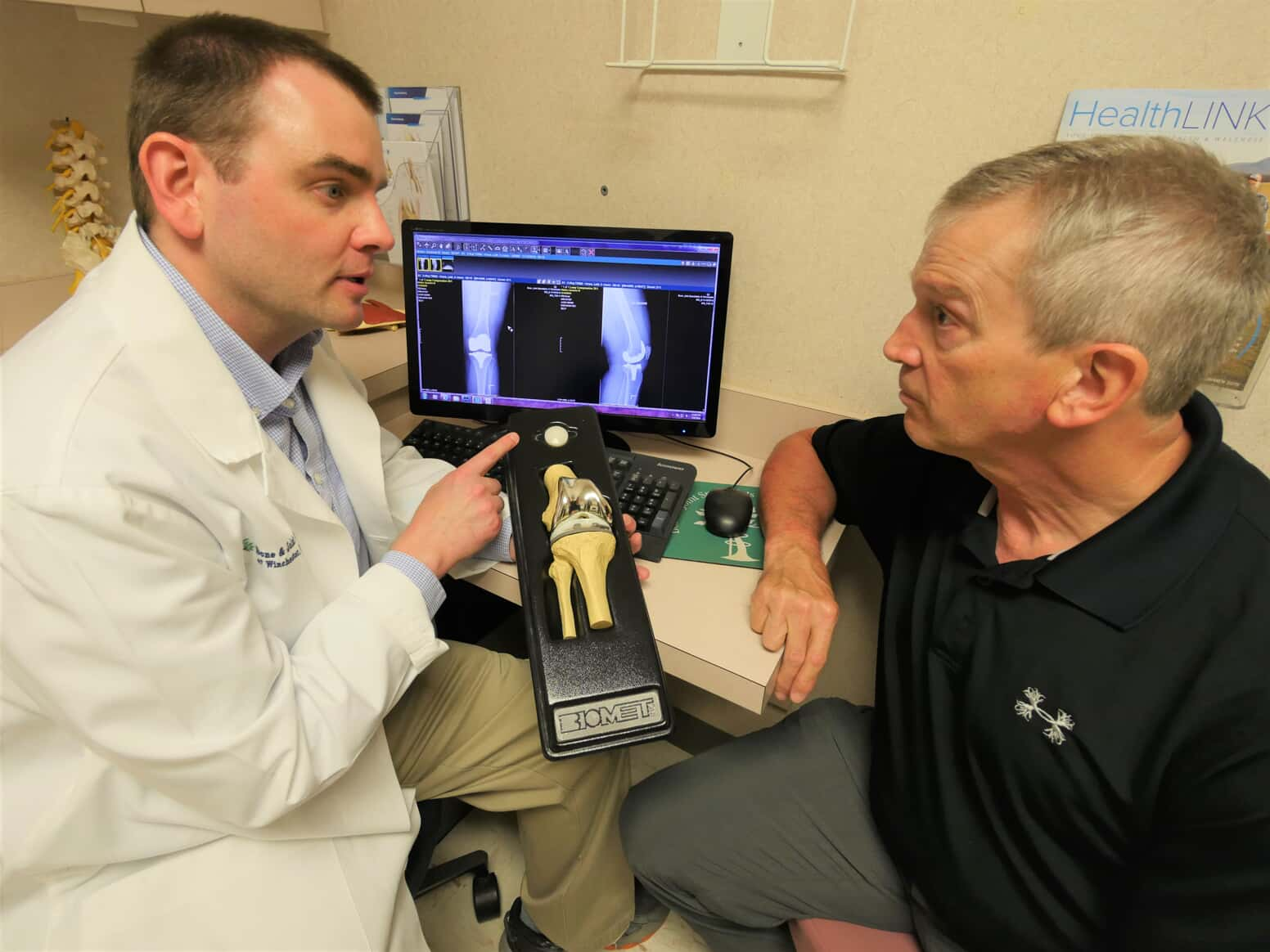 photo of Dr. Courtney discussing knee replacement with a patient
